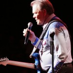 """Glen Campbell on stage, in """"Glen Campbell:  I'll Be Me"""""""