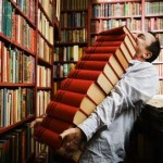 man-carrying-pile-of-books