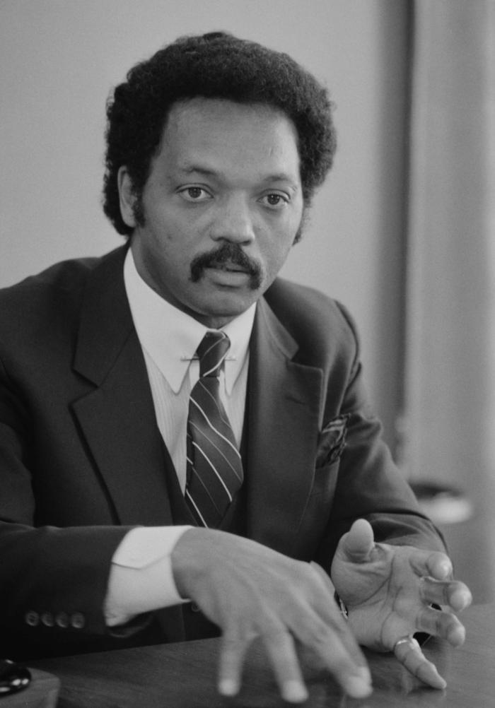 Jesse_Jackson,_half-length_portrait_of_Jackson_seated_at_a_table,_July_1,_1983_edit