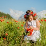 Girl on the poppy field by RadVila. Image via Shutterstock.
