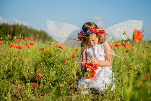 Girl on the poppy field by RadVila. Image via Shutterstock.