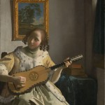 Johannes Vermeer (1632–1675), Young woman playing a guitar