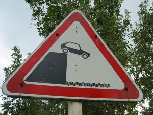 Car off cliff sign by BorisFromStockdale. CC license 3.0