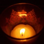 candle in lacy cup