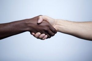an interracial handshake