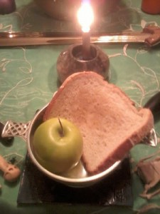 An offering of bread and an apple to the liminal Gods