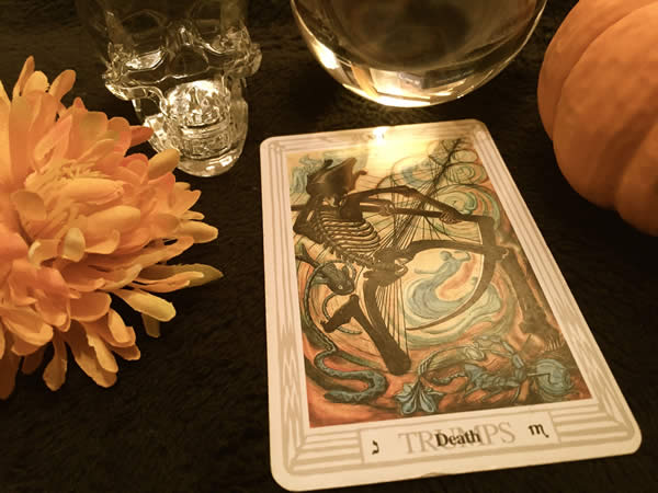 "a tarot card featuring a dancing skeleton labeled ""Death"""