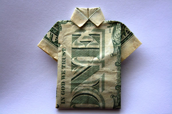 a dollar bill folded into the shape of a shirt