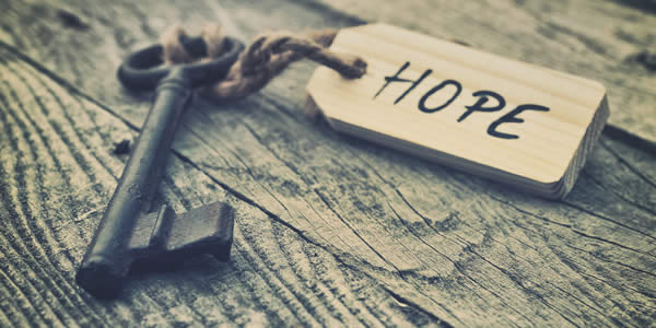 """a key with a label on which is written the word """"hope"""""""