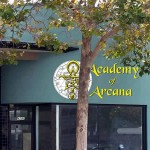 "the front of a building labeled ""Academy of Arcana"""