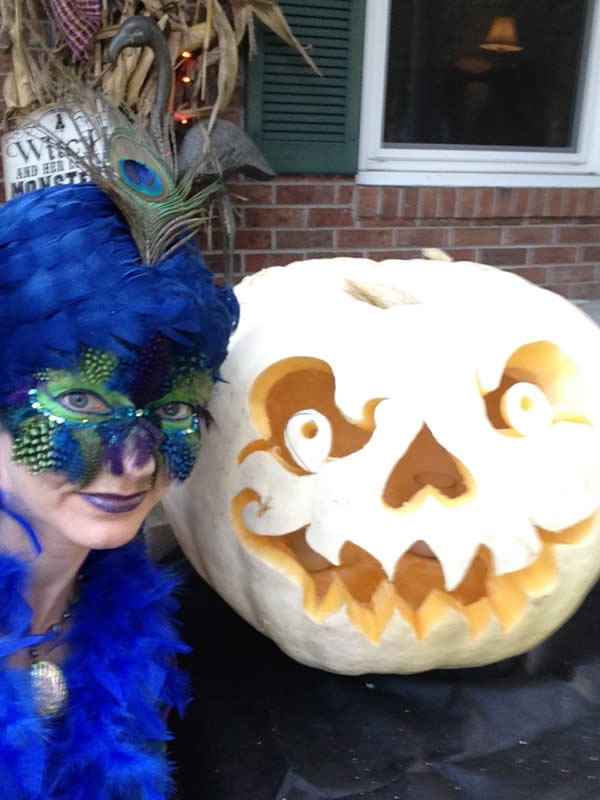 Heron and her Larger-Than-Strictly-Neccessary, Jack-the-Fabulous-Lantern, ready to welcome friends to her Halloween Party