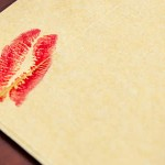 an envelop with a kiss-mark in lipstick on it