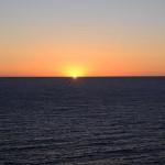 a sunrise over the ocean