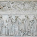 a relief sculpture of the muses on a the side of a sarcophagus
