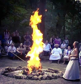 a group photograph showing ritual attendees around a fire