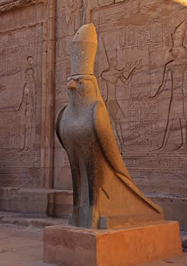 a statue of Heru (Horus) in the form of a hawk with a very large hat
