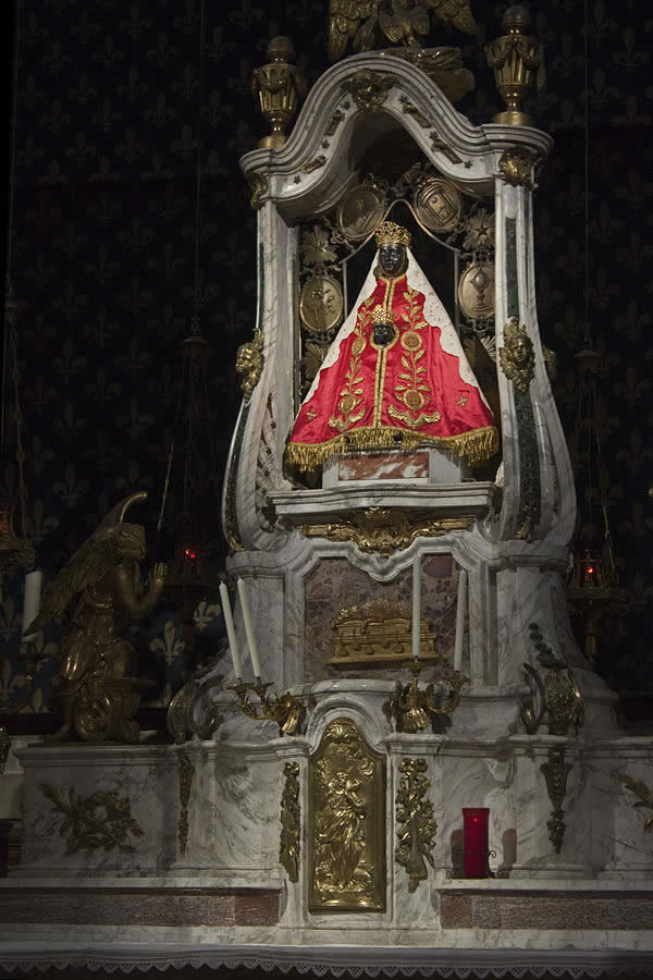 an ornate altar in a Catholic church depicting Christ and a Black Madonna