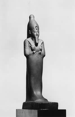 a statue of Osiris with his arms crossed