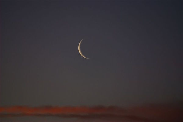 """New Moon at Sunset"" by Andrew McMillan.  Public Domain Image."