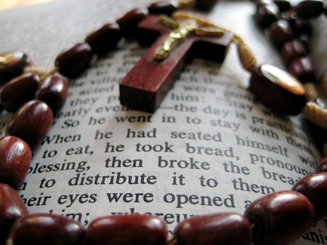 Rosary and Bible. Photo Credit: Chris Sloan.