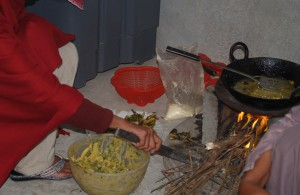 Making Fresh Aloo Pakoras (Fried Potato Dumplings) on a wood stove in the Pind (Village)
