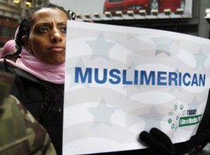 "A woman holds a sign at the ""Today, I am a Muslim, Too"" rally in New York City, March 6, 2011."