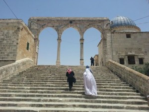 Tayyibah Taylor (in white) ascending the steps of the Dome of the Rock.