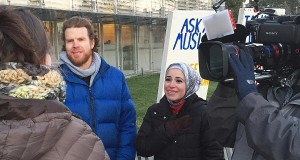 "Sebastian Robins and Mona Haydar at their ""Ask A Muslim"" booth - photo courtesy of Mona Haydar"