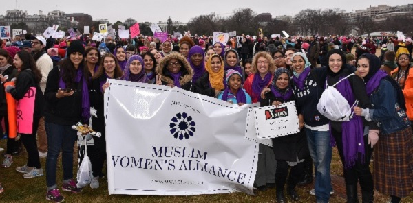 A large group of the Muslim Women's Alliance Marchers with the White House behind them in the background. Image source: MWA