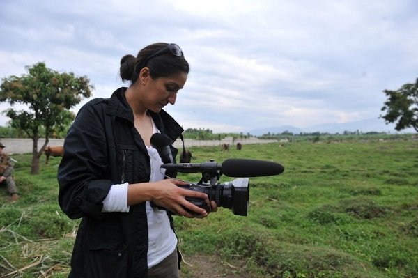Amna Nawaz on assignment in Haiti. Photo courtesy of author.
