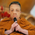 Macklemore punches Justin Bieber, becomes Buddhist monk
