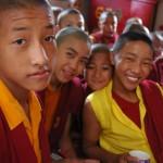 Young Tibetan boy monks in traditional robes, pose for a photo, tea break, Sakya Lamdre, side room, Tharlam Monastery of Tibetan Buddhism, Boudha, Kathmandu, Nepal (photo by flickr user Wonderlane, C.C.)