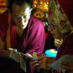 By the Book, Tibetan Text Experts, Master of Ceremonies assists Dagchen Rinpoche, closing the Hevajra Mandala, Tharlam Monastery, Kathmandu, Nepal (photo by flickr user Wonderlane; C.C. 2.0)