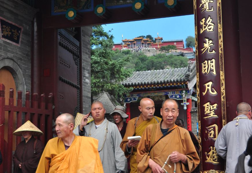 monks leaving a ceremony at wutai shan