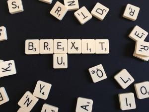 Scrabble tiles forming Brexit and EU
