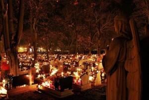 All Saints' candles burning in a Polish cemetery