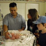New dad Noé, aunt Maura, uncle David and baby Robert in 2009.
