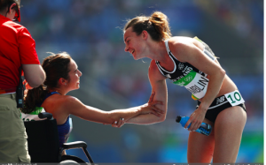 New Zealand's Nikki Hamblin helps American runner, Abbey D'Agostino, after she falls during the 5,000 meter preliminary race.