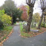Left hand graveyard path at Hawarden St Deiniol, by John S Turner via Wikimedia Commons
