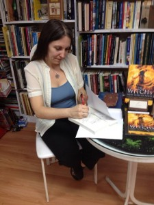 My first book signing!  Photo by Chiri Peterson.  Used by permission.