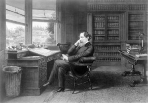 Charles Dickens at Publwriting Desk. Public domain image courtesy of Publicdomainpictures.net.