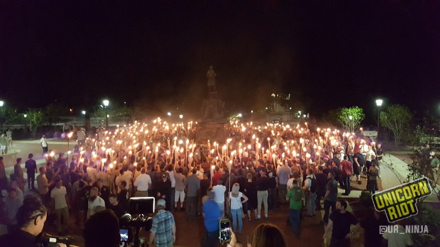 charlottesville - Unicorn Riot, wiki commons white-supremacist mob carrying torches attacks protestors