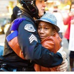 racial_divides_disappear_in_heartwarming_hug_photo_amid_ferguson_protests_m13