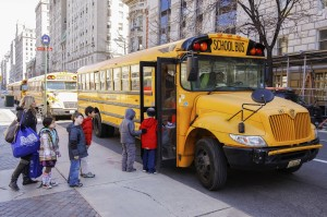 New York City, USA - March 03, 2011: Children entering school bu