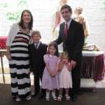 Our family following Mass, in front of a statue of St. John Vianney