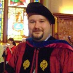 me in my Fordham robes, upon receiving my PhD