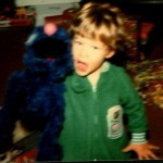 "Danny Fincke with a Grover puppet as a child on Christmas, unwittingly foreshadowing his days as a ""Grover"" at Grove City College."