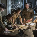several Monuments Men busily monumenting