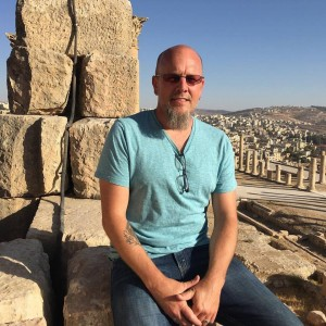 Sitting at the top of what originally was the Greek Temple of Zeus, later rebuilt as the Roman Temple of Jupiter, overlooking the ruins near Jarash, Jordan.
