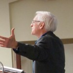 Matthew Fox opens his arms in prayer at the first Christ Path Seminar